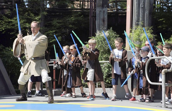 Jedi Master Noraz Divad and younglings during the Jedi Training Academy at Disney's Hollywood Studios, on Thursday, April 14, 2011.  After a year in which Universal Orlando rode the popularity of Harry Potter to record heights, Walt Disney World is pinning its fortunes on the intellectual property with which Potter is most often compared: Star Wars. Disney next month will open revamped versions of its popular Star Tours simulator rides in Orlando and Anaheim. The two-decade-old simulator technology is being replaced with state-of-the 3D effects and all-new film scenes shot by director George Lucas' movie studio. But Disney is banking on Star Wars to do more than just deliver crowds this summer. It also hopes the attraction will inject new life into a long line of Star Wars-themed merchandise, much the way Potter has fueled enormous souvenir sales at Universal. We look at the scope and impact of Disney's Star Wars merch and Universal's Potter results. (Ricardo Ramirez Buxeda / Orlando Sentinel) B581198320Z.1